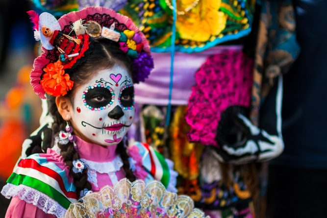 A young girl, dressed as La Catrina, a Mexican pop culture icon representing the Death, takes part in the Day of the Dead festivities in Mexico City, Mexico, 28 October 2016. Day of the Dead (Día de Muertos), a syncretic religious holiday combining the death veneration rituals of the ancient Aztec culture with the Catholic practice, is celebrated throughout all Mexico. Based on the belief that the souls of the departed may come back to this world on that day, people gather at the gravesites in cemeteries praying, drinking and playing music, to joyfully remember friends or family members who have died and to support their souls on the spiritual journey.